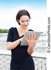 Beautiful woman using electronic tablet