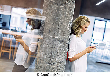 Beautiful woman using mobile phone