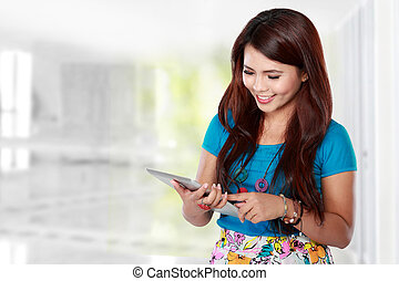 Beautiful woman using tablet