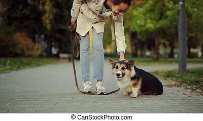 Beautiful Woman Walking Cute Dog In Nature - Beautiful woman...
