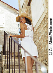 Beautiful woman walking down the stairs