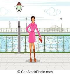 Beautiful woman walking in city