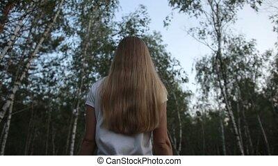 Beautiful woman walking through birch grove - Beautiful long...