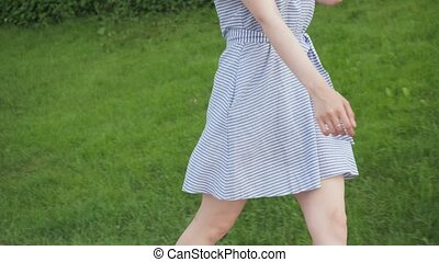 Beautiful woman walking with romantic mood in the summer.
