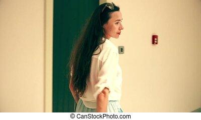 Beautiful woman walks in a modern hotel