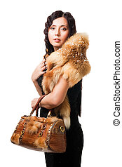 Beautiful woman wear fur with purse, isolated on white