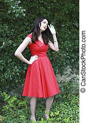 Beautiful woman wearing a red dress