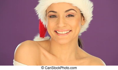 Beautiful woman wearing a Santa hat