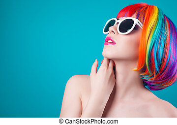beautiful woman wearing colorful wig and white sunglasses...