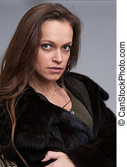 beautiful woman wearing fur coat
