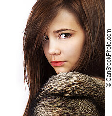 Beautiful woman wearing fur coat