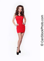 Beautiful woman wearing in red dress posing isolated on white background