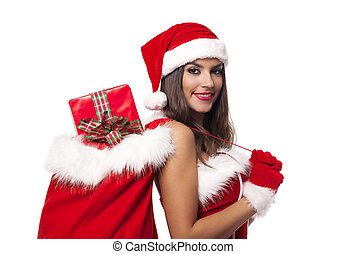 Beautiful woman wearing santa claus clothes holding sack full of christmas gifts
