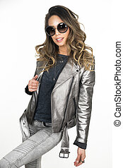 Beautiful woman wearing silver jacket and sunglasses