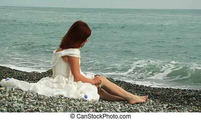 Beautiful Woman Wearing Stockings Sitting on Beach
