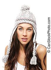 beautiful woman wearing winter cap on white background