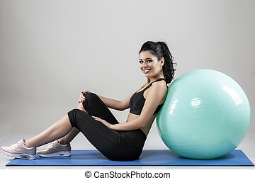 beautiful woman with a ball isolated on background