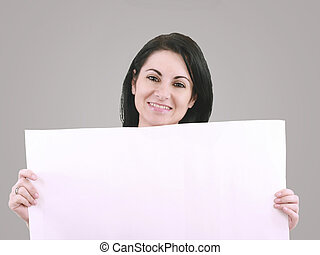 Beautiful woman with a banner smiling