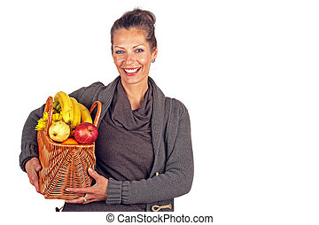 Beautiful woman with a basket full of fruits and flowers