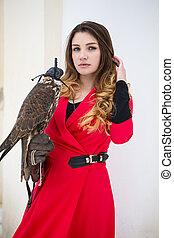 Beautiful woman with a bird