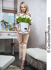 Beautiful woman with a bouquet in hands