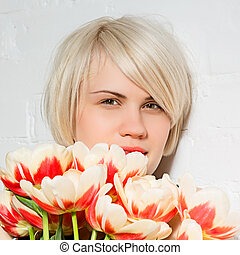 beautiful woman with a bouquet of roses