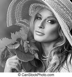 beautiful woman with a bouquet of sunflowers. black and white