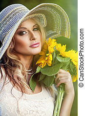 beautiful woman with a bouquet of sunflowers