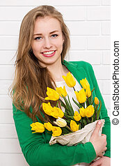 beautiful woman with a bouquet of tulips