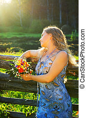 Beautiful woman with a bunch of flowers