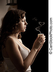 Beautiful woman with a candle in love