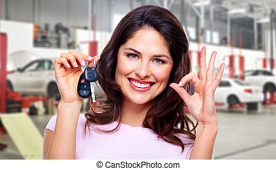 Beautiful woman with a car key.
