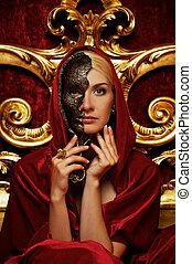 Beautiful woman with a carnival mask