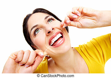 Beautiful woman with a dental floss. Dentist health care...