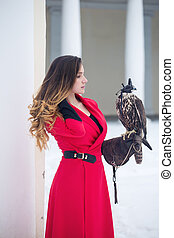Beautiful woman with a falcon