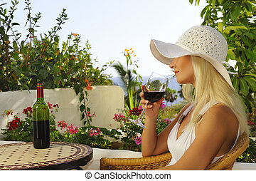 Beautiful woman with a glass of wine