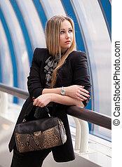 Beautiful woman with a handbag
