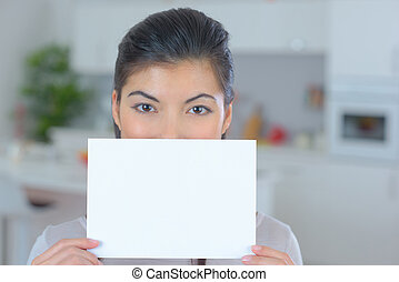 beautiful woman with a paper in the hands