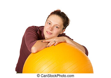 Beautiful woman with a pilates ball - Beautiful young woman...