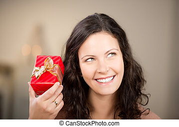 Beautiful woman with a romantic red gift