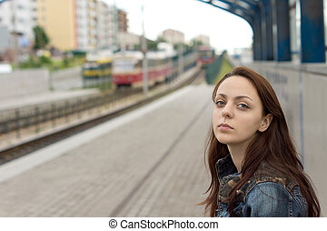 Beautiful woman with a sad expression waiting