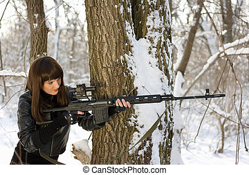 Beautiful woman with a sniper rifle