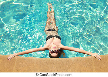 Woman With a Swimming Pool During Summer
