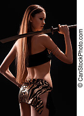 beautiful woman with a sword in the studio