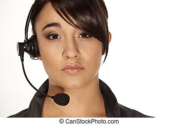 Beautiful woman with a telephone headset looking at camera.