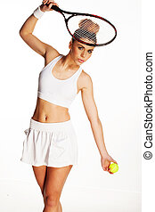 Beautiful woman with a tennis racquet and ball