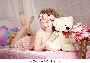 Beautiful woman  with a toy bear