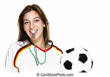 beautiful woman with a whistle holding football on white background