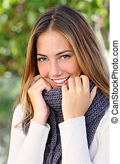 Beautiful woman with a white perfect smile in winter