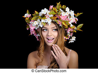 Beautiful woman with a wreath of flowers